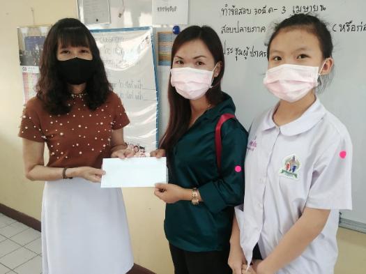 Famille de réfugiés à Bangkok qui ont pu bénéficier de l'aide post-covid