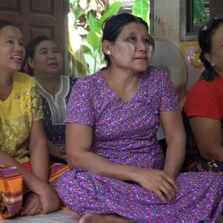 Visage de femme présentes à un séminaire sur les violences domestiques en Thaïlande.